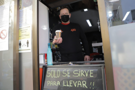 A sign outside a café in Palma states that it is only open for takeaways