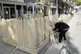 Bar owner in Palma, Mallorca, removing a temporary terrace