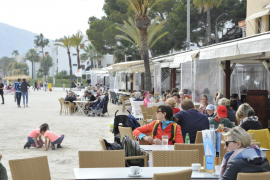 Tourists are seen in Alcudia during the Easter season in 2019