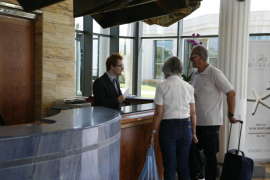 Tourists at a hotel paying for the tourist tax
